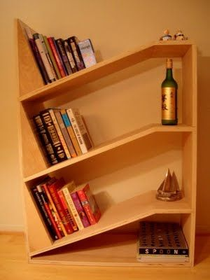 No Bookends Required On These Slanted Bookshelves