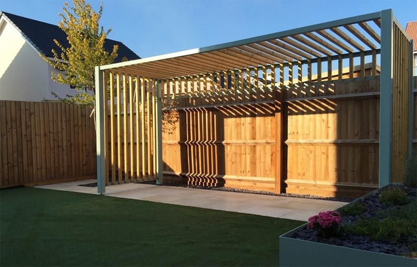 Modern Pergola Against Wood Fence