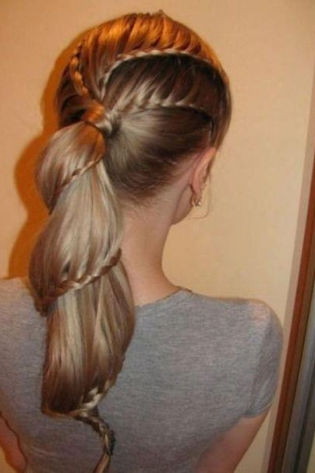 That's awesome... no idea how to do that... but... still pretty cool. Maybe i wouldn't do that down the ponytail tho...cool volleyball hairstyle :)