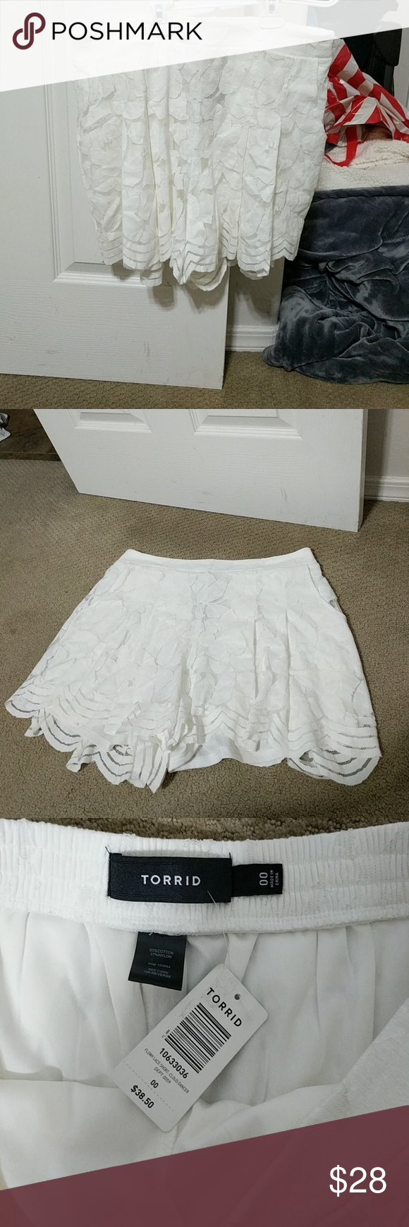 Torrid lace flowy shorts size 00/10 New with tags. Torrid 00 is equal to a women's 10 torrid Shorts