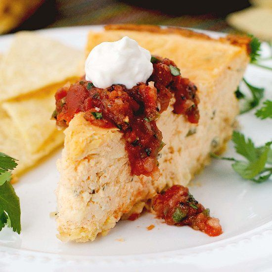 """This savory """"cheesecake"""" is packed full of spicy Tex-Mex flavor. Baked in a springform pan, it's a fun change from standard dips & spreads."""