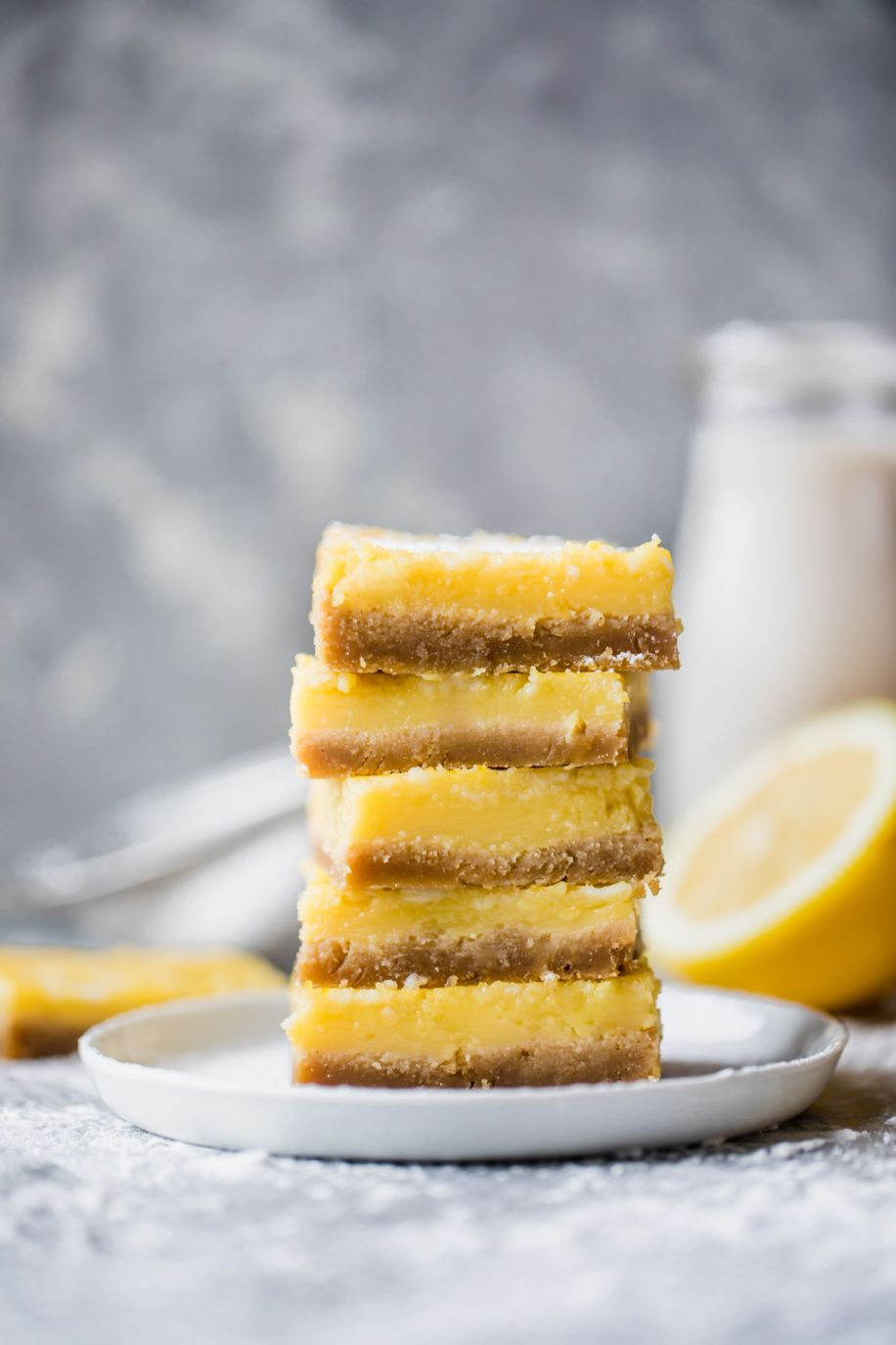 Healthy lemon bars that are gluten free, dairy free and paleo! The crust is made with a mix of almond flour and coconut flour and the light lemon filling is made with just 4 simple ingredients: fresh lemon juice, honey, eggs and coconut flour. You're going to LOVE these easy to make bars -- they're great for parties! #lemonbars #glutenfreedessert #grainfree #paleodiet #paleodessert #healthydessert
