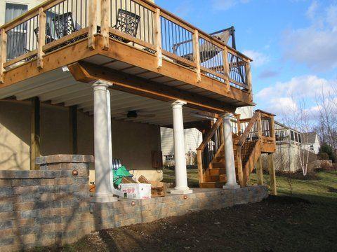 Covered deck designs patio deck and walkout basement for Deck ideas above walkout basement