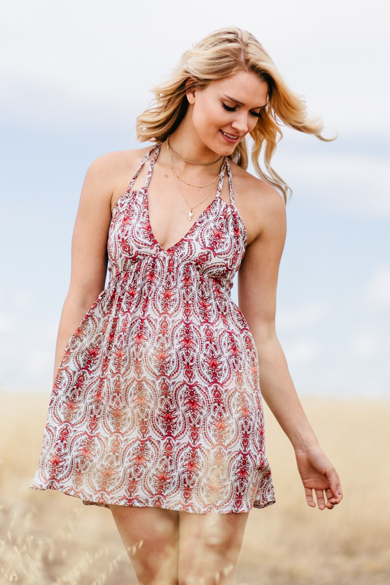 5be9651e5316 Adorable printed halter style dress with strap detailing and a criss cross  back! Vacation Dresses