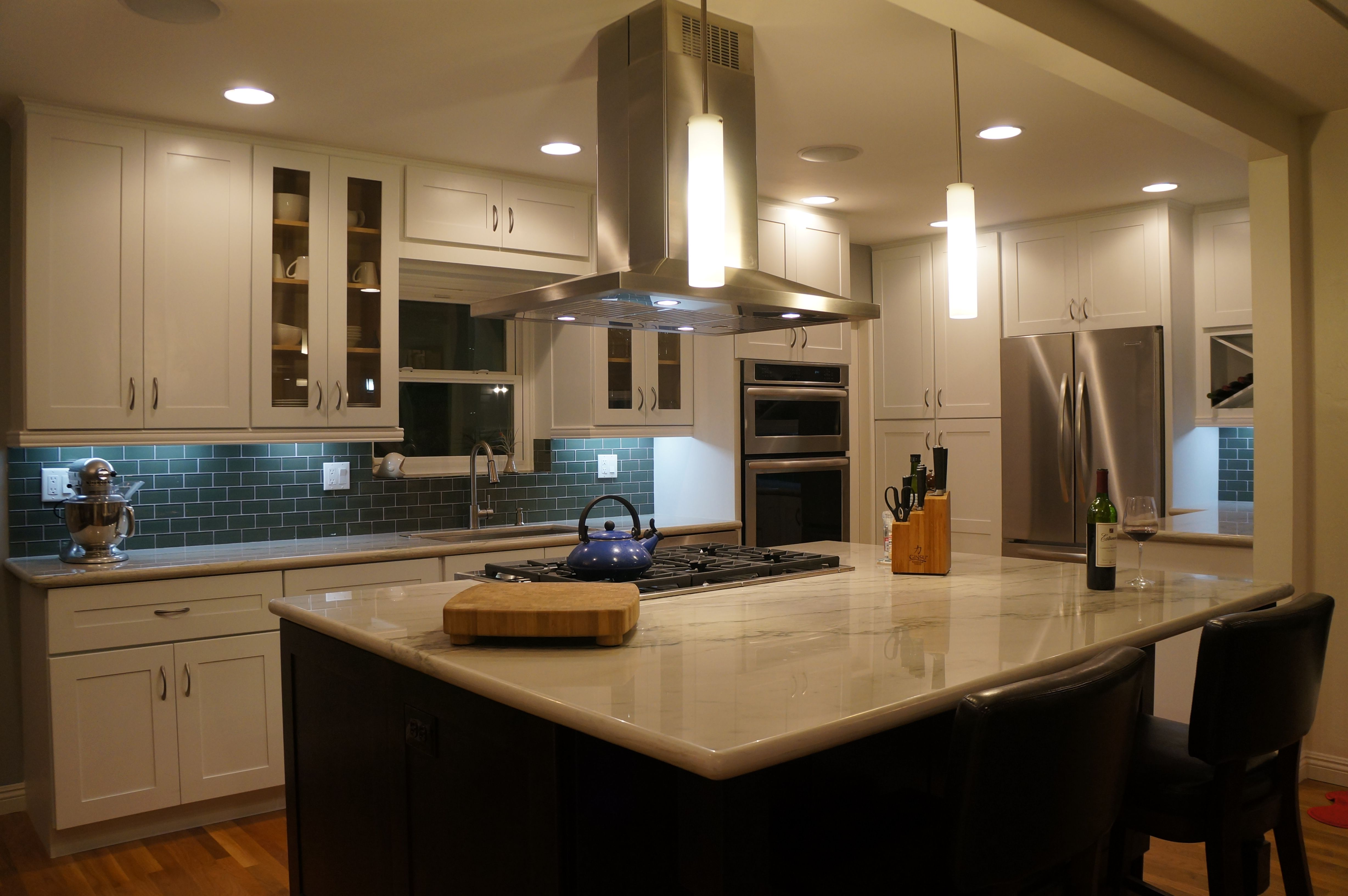 White cabinets espresso island quartzite counter pewter glass