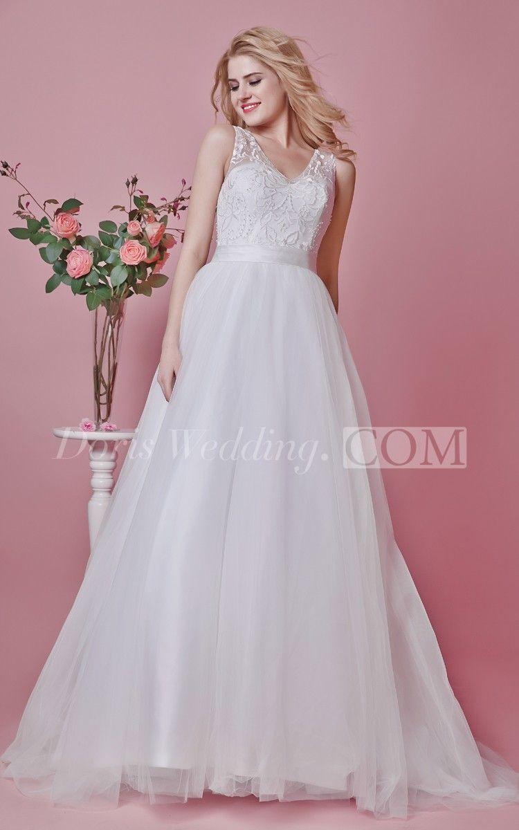 Become an elegant vision on your wedding day in this stunning femme v-neck lace applique and tulle wedding gown. A beautiful a-line silhouette slims your form with a fitted bodice and full-length tulle skirt. An illusion v-neckline complements a sweetheart neckline and is embellished with beautiful lace appliques and beading for an eye-catching look as you walk down the aisle. #Doris #Wedding #Lace #Long #Wedding #Dresses #2016