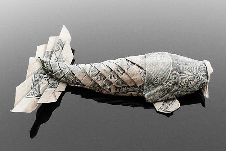 Origami fish made of money