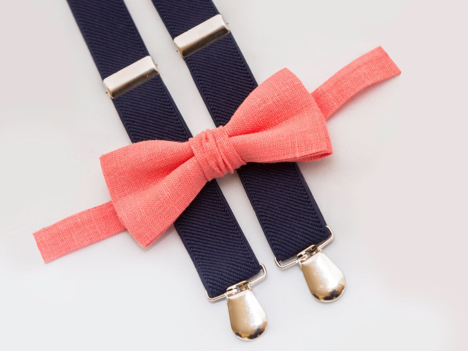 coral bow tie & navy blue suspenders, ring bearer outfit, groomsmen bow tie suspenders by CutieAccessorieStore on Etsy https://www.etsy.com/listing/278877202/coral-bow-tie-navy-blue-suspenders-ring