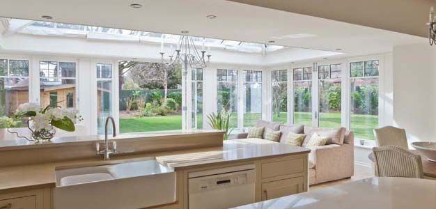 The addition of this conservatory allows light to flood into the ...