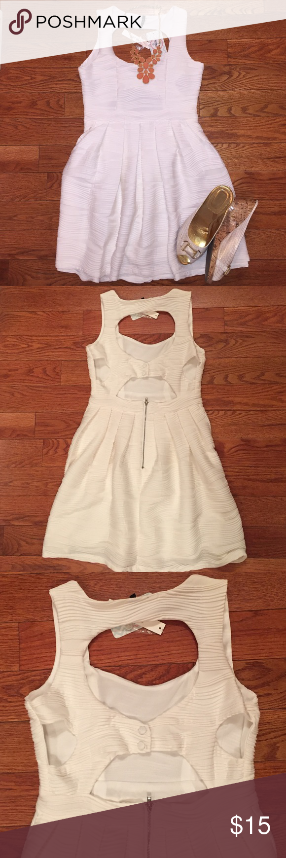 White textured cut out dress White textured mini dress with back cut outs. It is really flowy and soft. It is completely lined. Perfect for brides to be! This does fit on the smaller side. Dresses Mini