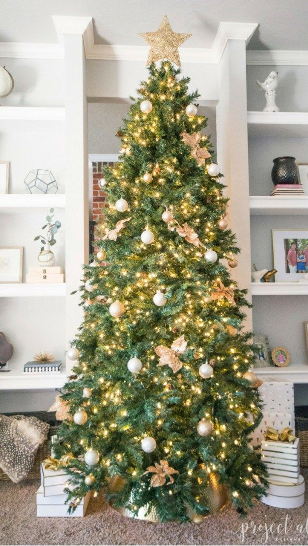 Modern Glam Christmas tree with gold ornaments, brass tree