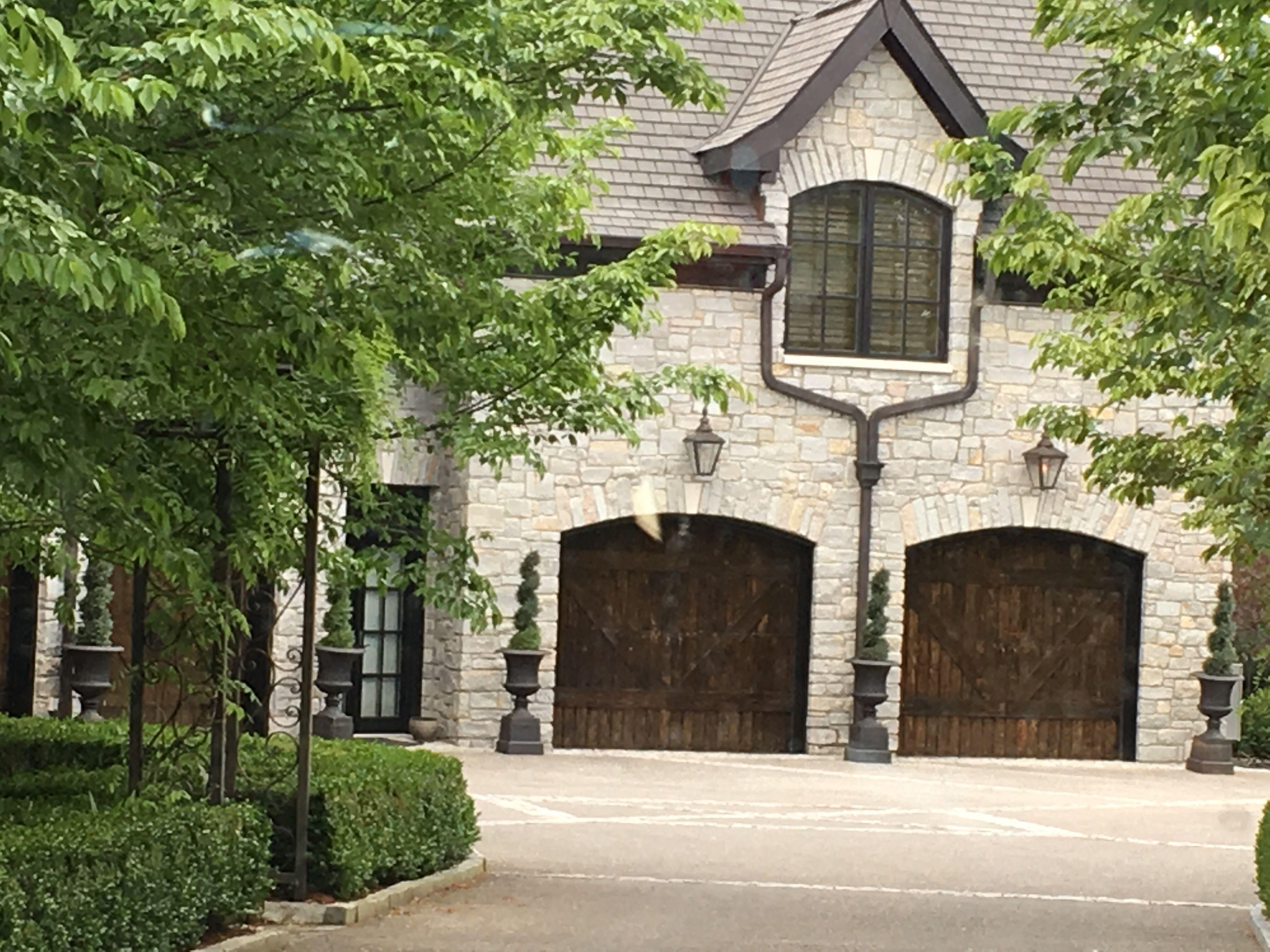 Light Stone With Dark Wooden Garage Doors And Trim Wooden Garage