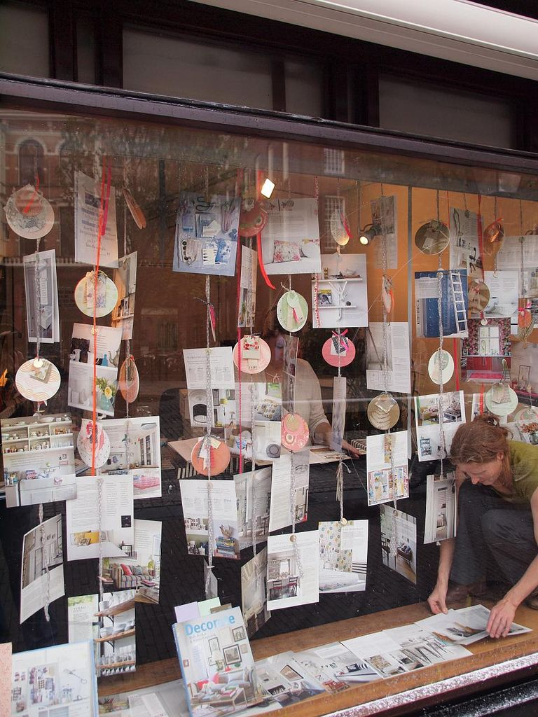 Window Display idea - ribbon with contact sheets, photos, decorations?