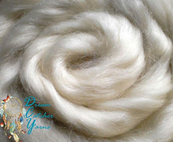 A Half Pound ~ 8 ounces~ of Absolutely Angelic Natural Snowy Natural White Color Mohair Goat Wool Fiber Top Roving Fiber from the USA for Spinning, Dyeing, Doll Making & Fiber Crafts!  Fiber Facts... * Dream Catchers Yarn Domestic USA Goat Hair Fiber Mohair Natural Cream White color Wool Top Roving * A++ High Quality ~ Sweet Angel Hair ~ Decadently Luxury Fiber! * One Half Pound, 8 ounces of ready to spin, dye (This dyes absolutely GORGEOUSLY!) or craft wool roving * Natural, undyed gorge...