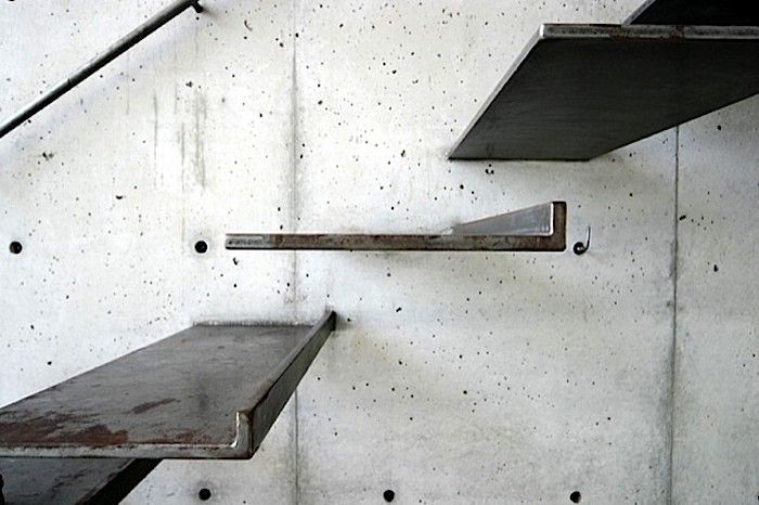 sophisticated floating stairs. contrast between the rustic style stairs and wall. unique japanese style.