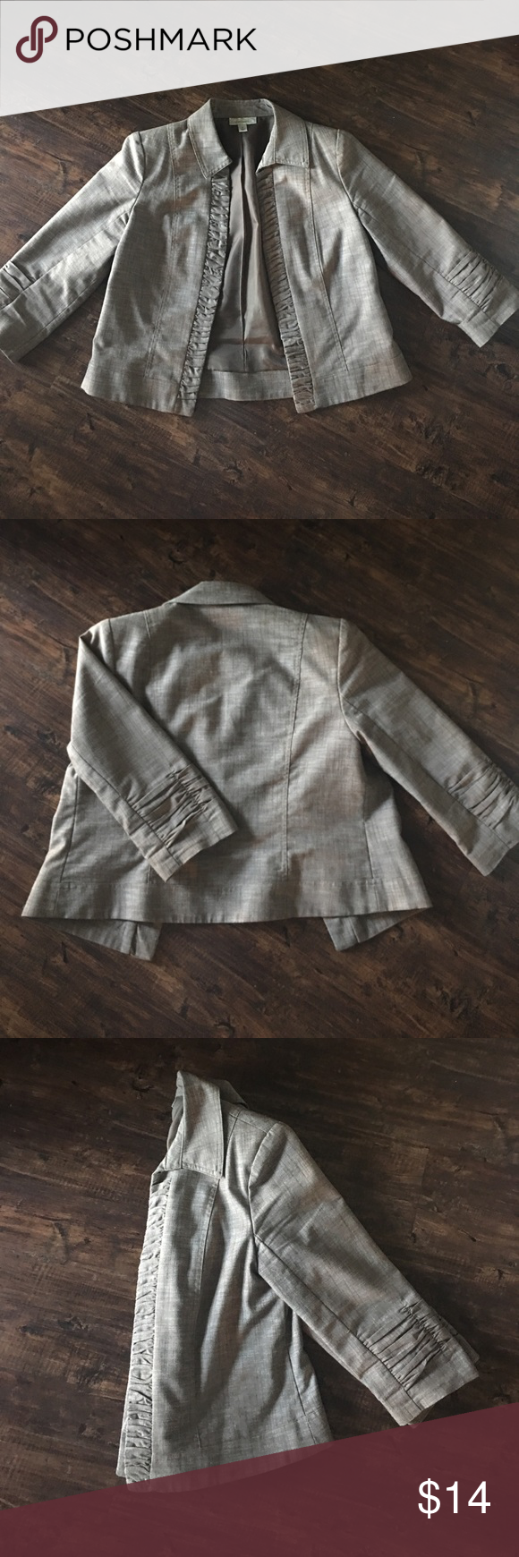 Brown blazer Brown structured blazer. Shorter fit with roushed front detail and sleeves. Slight shoulder pads in order to create structure. No buttons or closures. Dress Barn Jackets & Coats Blazers