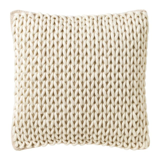 Cojín de lana y algodón con un ligero y discreto acabado trenzado ...