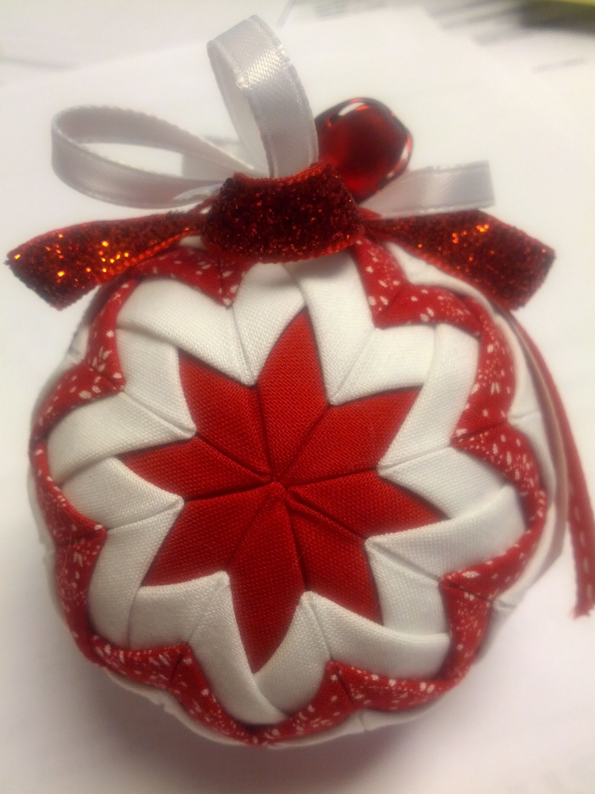 DIY ornament made out of foam ball, fabric, straight pins