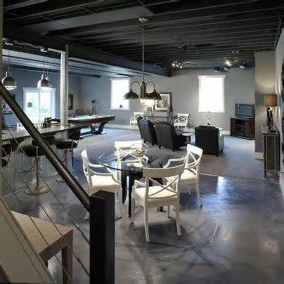 Industrial basement decor black ceiling polish concrete for Rugs for basement floors