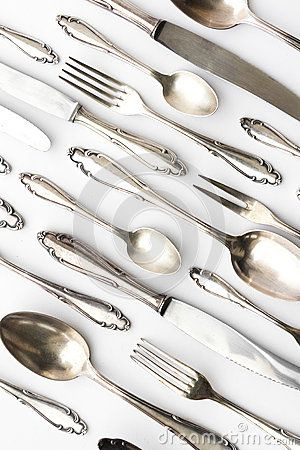 Beautiful sterling cutlery collection on white background
