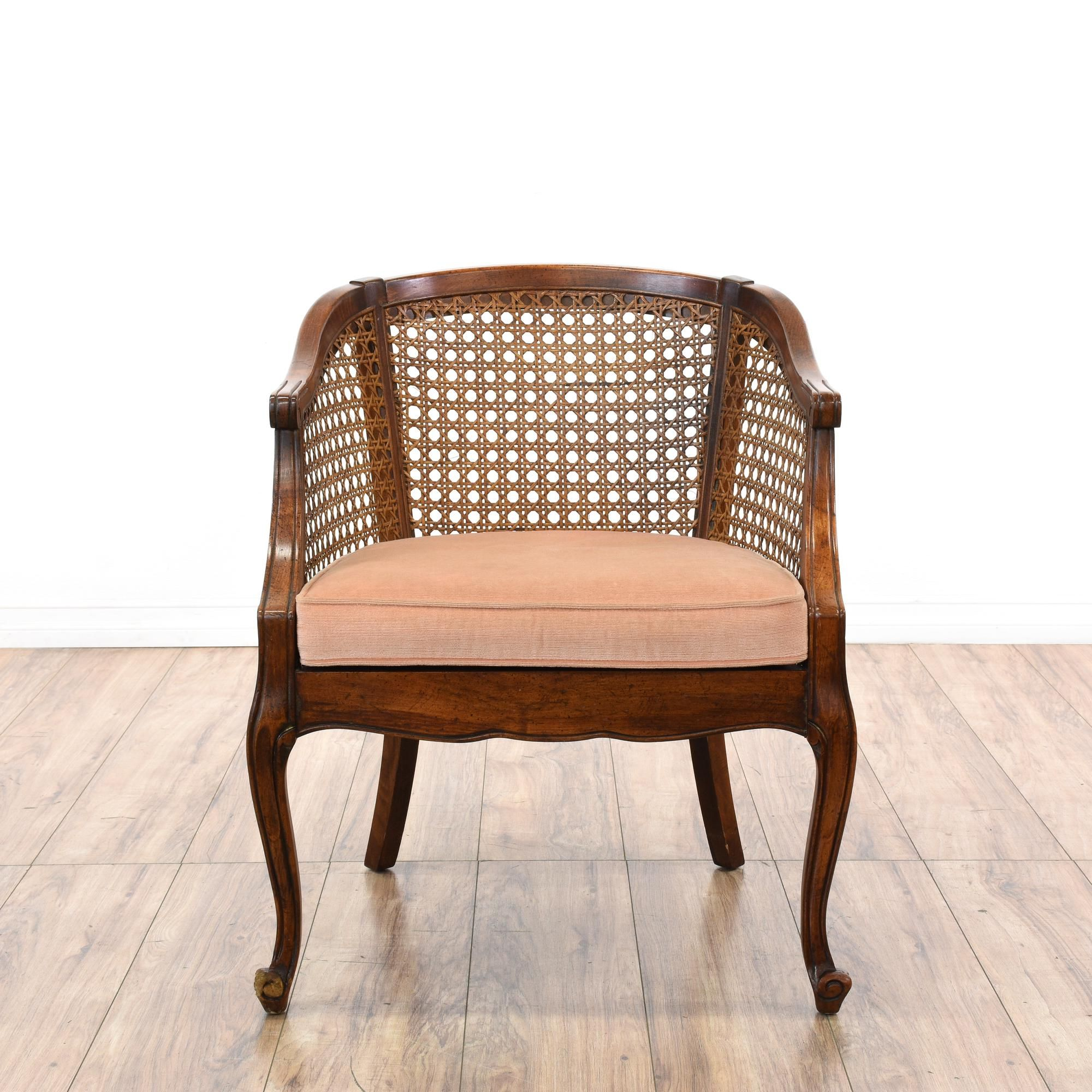 This pair of barrel back chairs are featured in a solid wood with