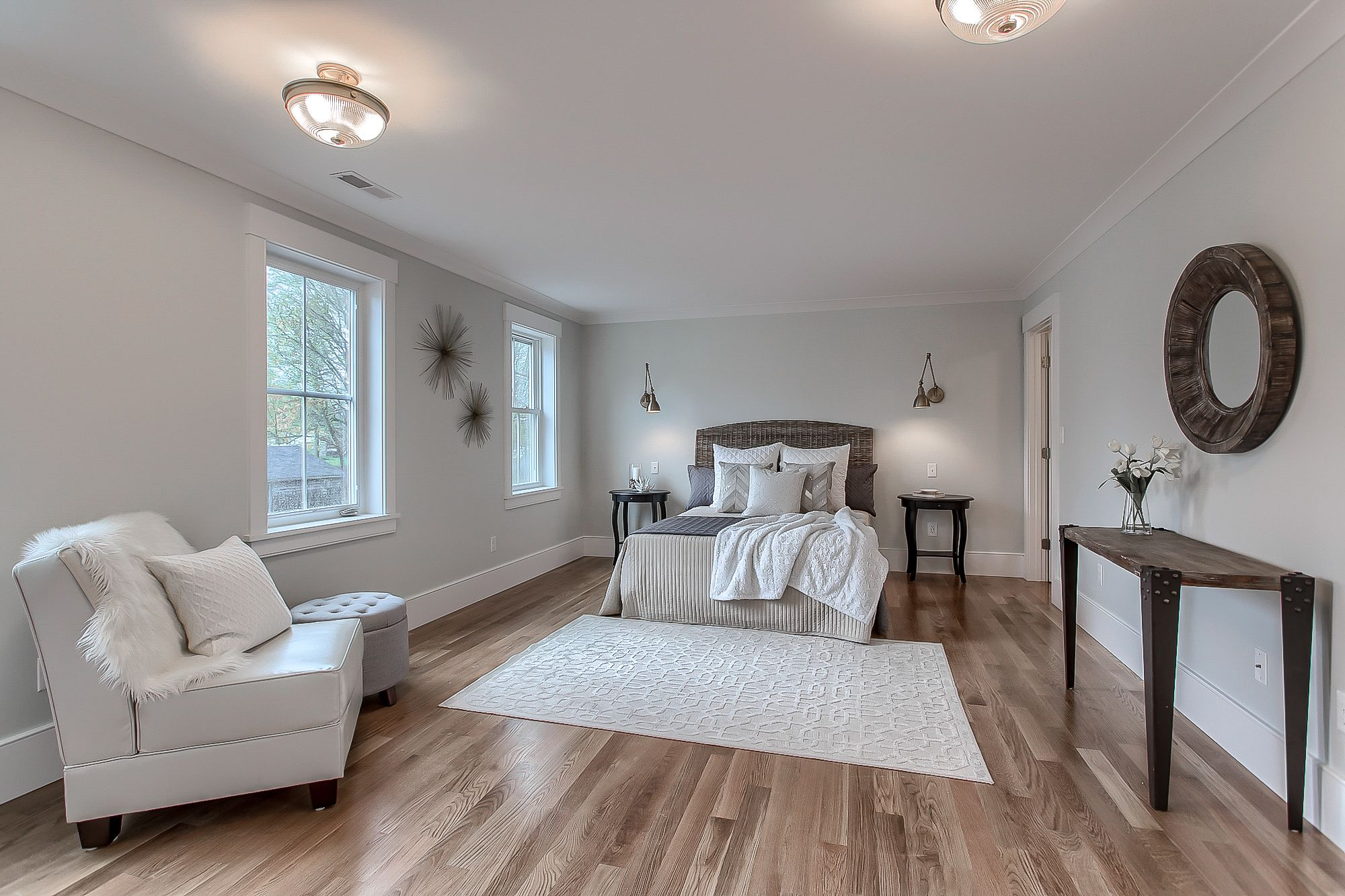 Master bedroom flooring  A beautifully styled master bedroom with gleaming oak floors This