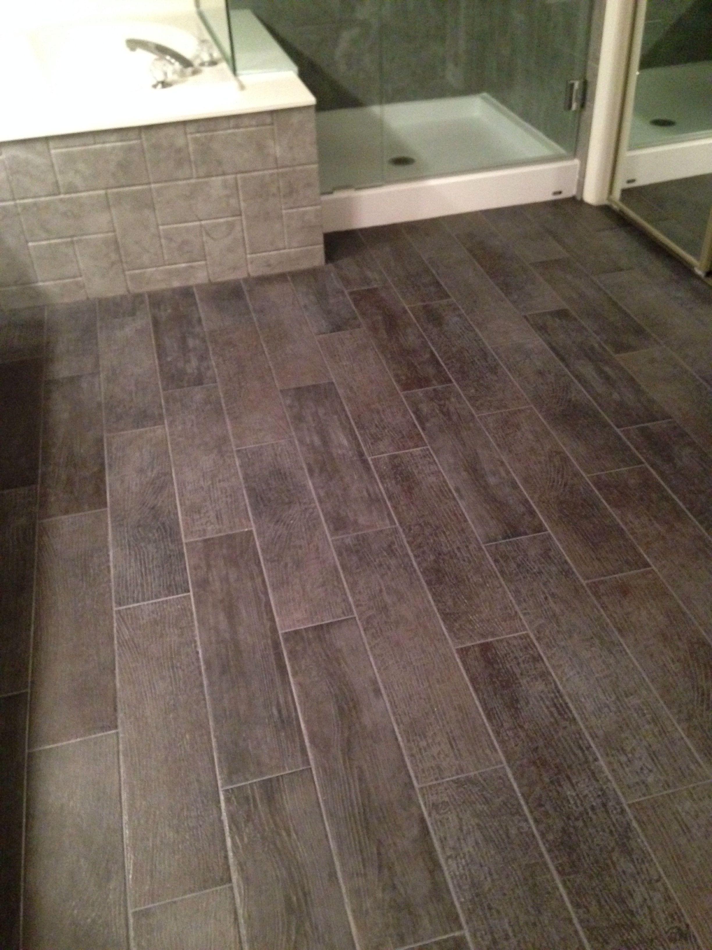 Bathroom floor 6x24 tiles charcoal gray look like wood for Wood floor in bathroom