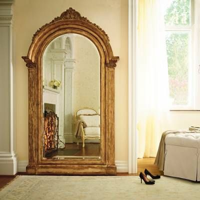 The Elizabeth Storage Mirror, set in a gorgeous wood frame with a multistep, bronze painted and distressed finish, rests on the floor and attaches to the wall for stability. The felt-lined interior of this arched antique mirror is specifically designed for organizing and storing your favorite jewelry items. 36 pouches for earrings or brooches20 double hooks for necklaces or large braceletsTwo shallow shelves36 cushioned ring slotsKeeps your jewelry neat, untangled, and readily visible for…