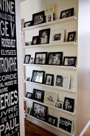 picture ledges shelves for a photo wall (pic from manditremayne.blogspot.com <--- her version of the easy Ana White ten dollar ledges found here ---> http://ana-white.com/2010/10/plans/ten-dollar-ledges