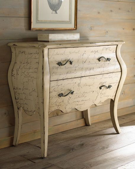 """Calligraphy"" Chest  $1,099.00  Curvaceous French-style chest adds charm to the decor while offering ample storage. Imported.  Handcrafted of hardwood solids and laminated lumber.  Cast hardware.  Hand painted with French script.  Aged, physically distressed parchment finish.  Two drawers.  40.75""W X 18""D X 34""T."
