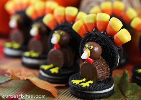 Check out these awesome thanksgiving day treats...must try!  candy corn dbl stuffed oreos choco frosting yellow frostin red frosting whoppers butter mini reses cups