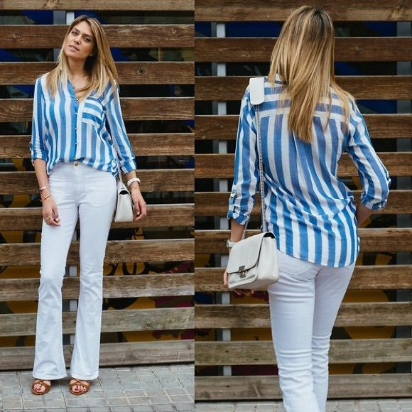 Blue and White Striped Button Down Blouse This adorable blouse is perfect for spring and summer! It is sheer with a tie at the bottom. The sleeves are long and there are cuffs that button on them. Forever 21 Tops Blouses
