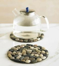 Photo of Stones + CD = great homemade trivet! Clever idea.