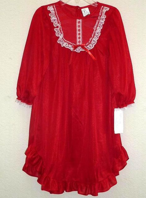 Toddlers red night gown is flame resistant and made in the USA.