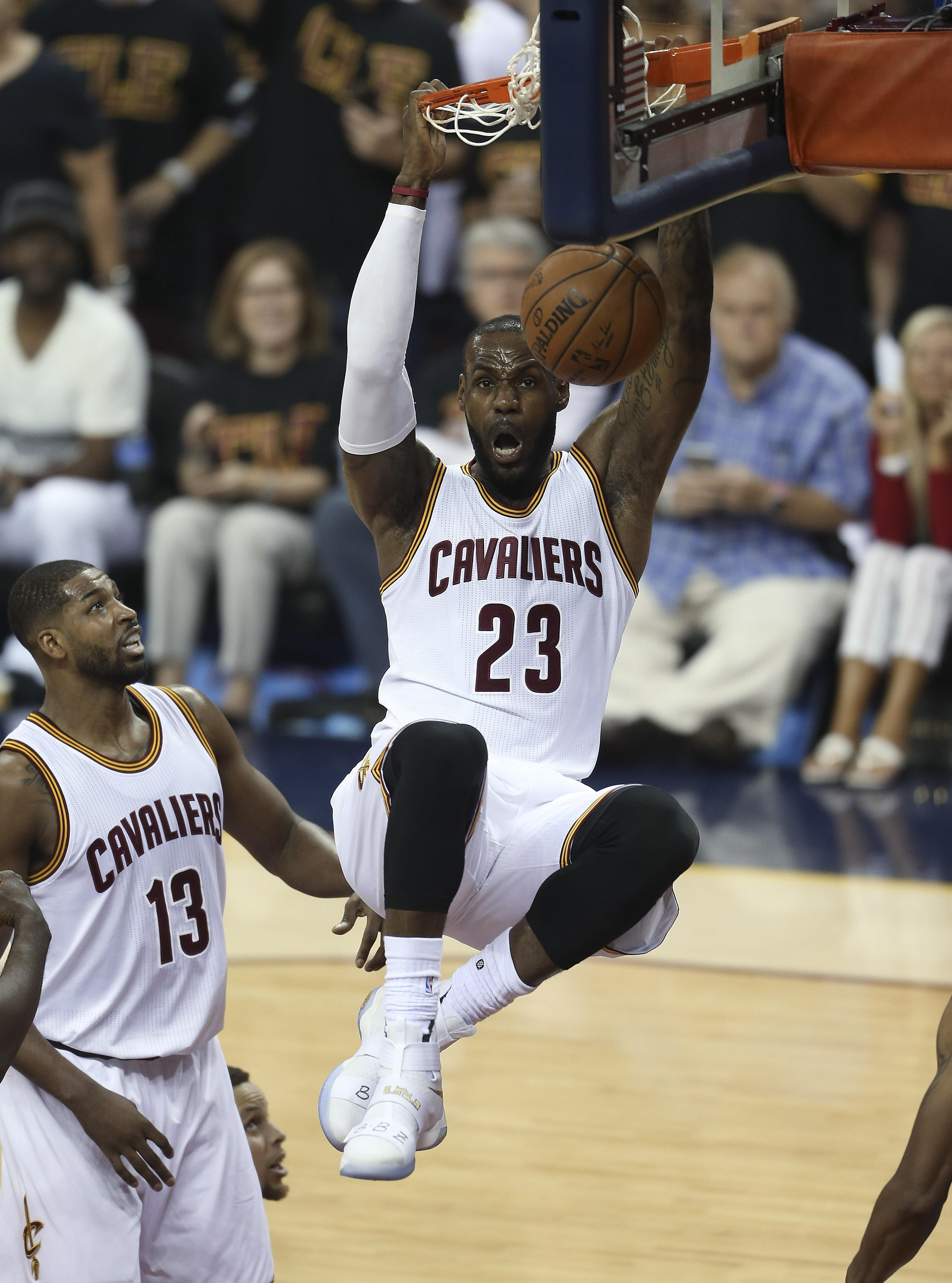 a1ed14a20f77d Cleveland Cavaliers forward LeBron James (23) dunks against the Golden  State Warriors during the first half of Game 6 of basketball s NBA Finals  in ...
