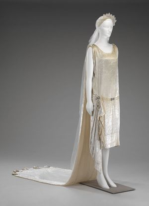 Wedding dress, chemise, train, veil. American, 1925. Silk velvet, silk satin, linen lace, silk net, glass pearls & rhinestones.