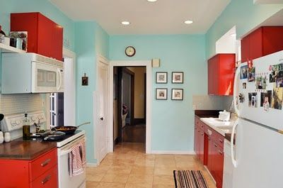 Red and Aqua kitchen! Love the vintage feel!