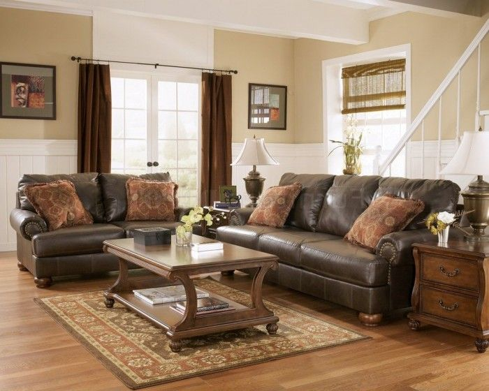 with brown leather furniture