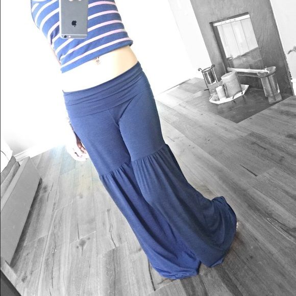 🌻Last Navy🌻Boho Tiered Palazzo Bell Bottoms Available in Navy and Black. Navy in large left only. {Tagged Free People for style reference}                                                                                    Amazing wide leg palazzo pants with a tier stitched at mid thigh. Soft and comfortable has a stretch. Breezy material perfect for summer!   Waist can be worn up or folded over.   Please message with questions Free People Pants Wide Leg