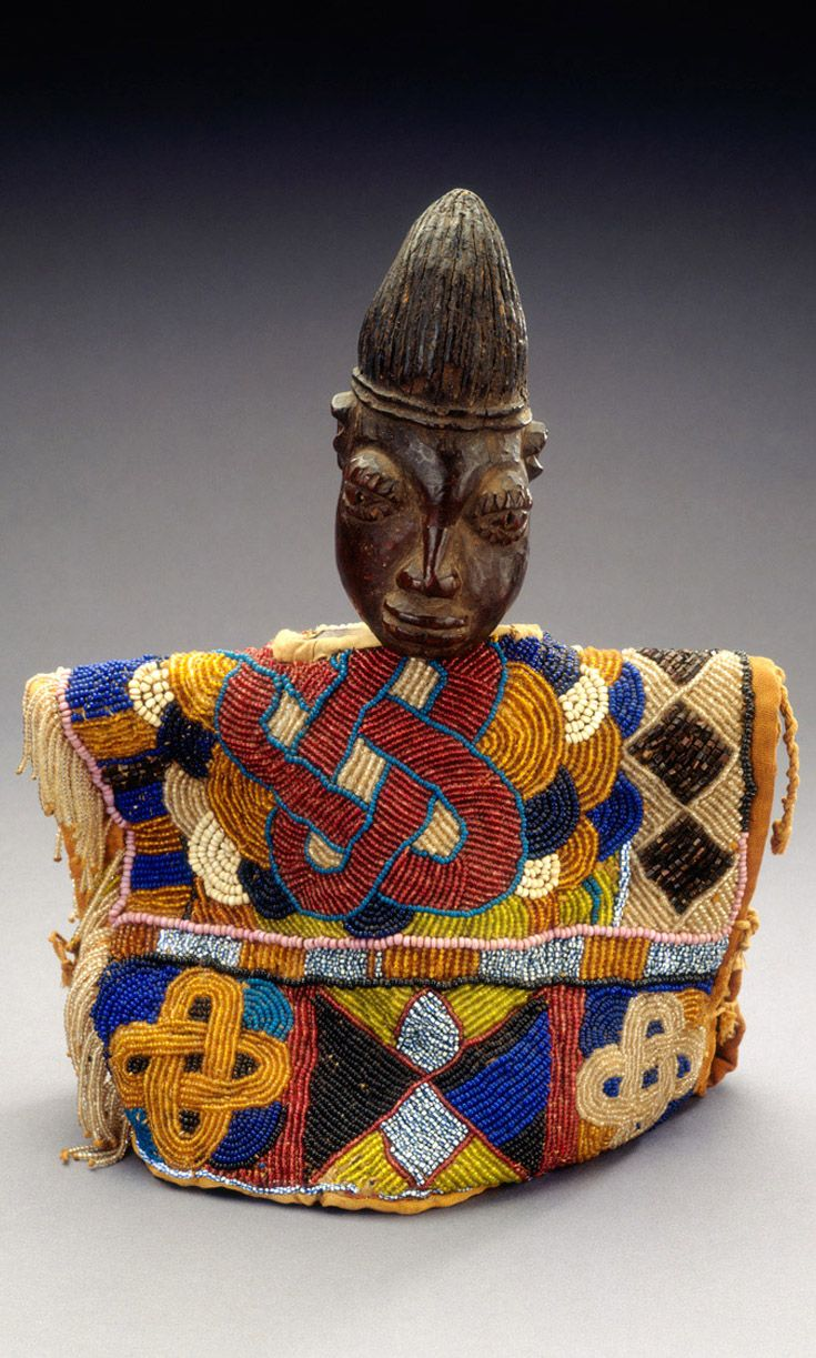 Africa ibeji with beaded gown from the Yoruba people of Nigeria