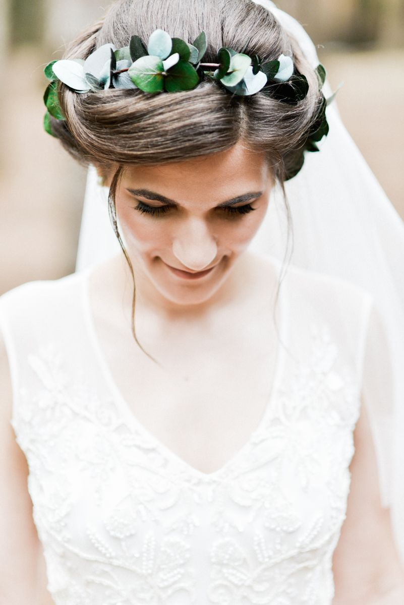 bridal updo with eucalyptus greenery crown intertwined within ...