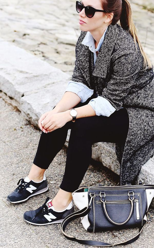 Pairing leggings with a button-up shirt, a tweed coat, or a chunky sweater is an easy (and comfortable) way to embrace the athleisure trend this fall. #Athleisure #Fashion