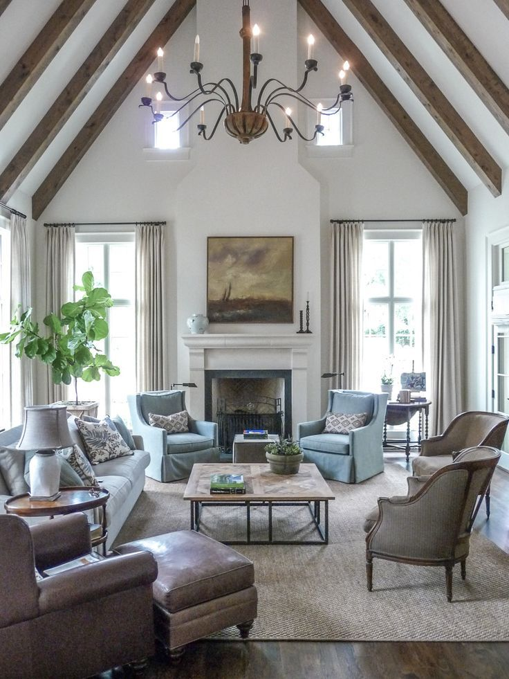 A gorgeous vaulted ceiling makes this living room feel - Interior design ceiling living room ...