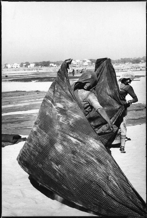 5f71fd7c309 Magnum Photos Photographer Portfolio Henri Cartier-Bresson INDIA. Gujarat.  Ahmedabad. 1966. Women spreading out their saris before the sun.