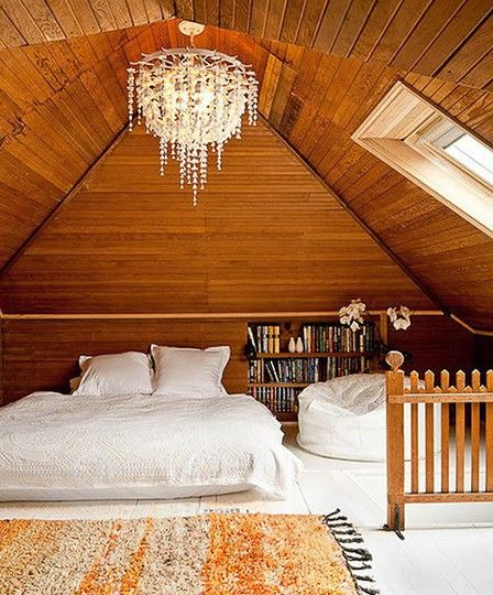 Brightly lit attic bedroom, but don't like chandelier, even though it's a nice touch
