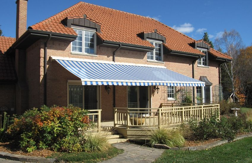 Bright Rolltec Awning On Mediterranean Style House Rolltec