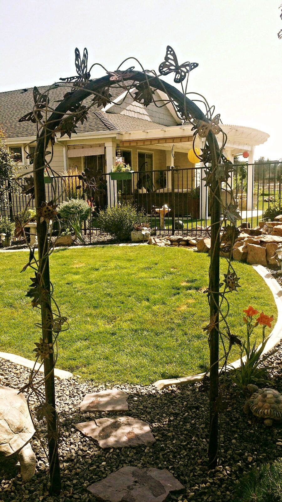 all metal arbor covered in butterflies, dragonflies, flowers all ...