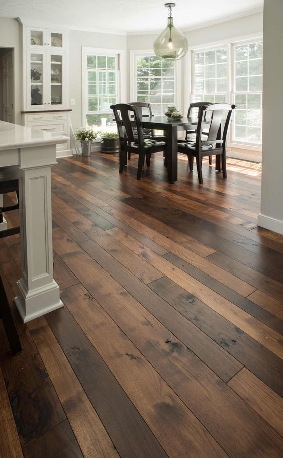 This Two-Tone Hickory floor is finished in both our Rich Tobacco and Golden Brown for a more varied look. Shown in widths 3