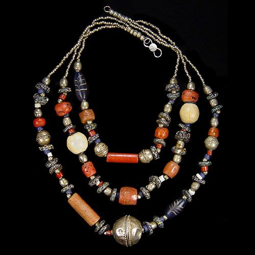 by Amelia Herrán | Old silver bead from Ethiopia (ca. 1900), old Venetian glass trade beads (1800 - 1920), old cow bone bead (1900) from Kenya and old African stone beads (early 1900s) | Price on request