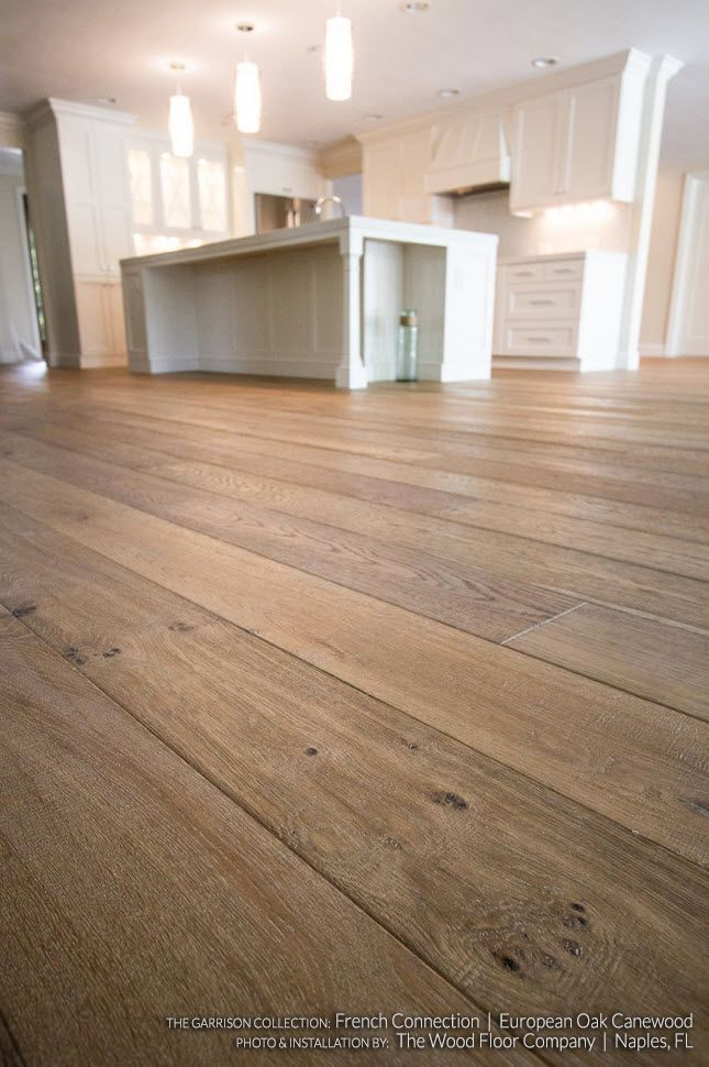 Rustic Tan Wood Plank Flooring With Visible Dark Knots The Wire Brushed Wide Planks Are Made F Wood Flooring Uk Engineered Wood Floors Oak Engineered Hardwood
